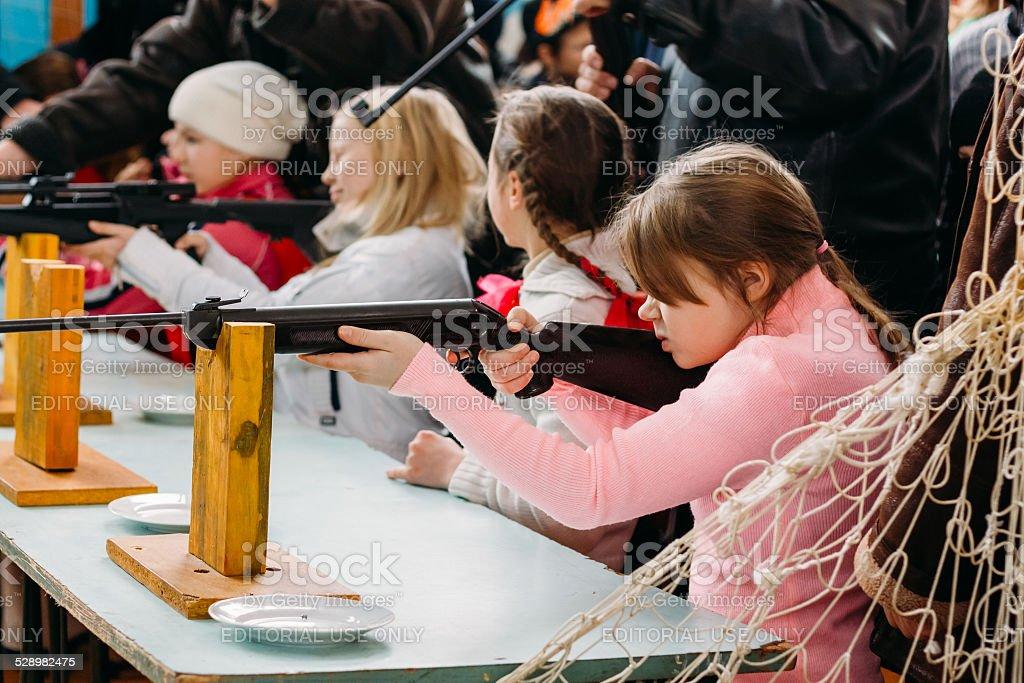 Unrecognizable Belarusian secondary school pupils girls shooting stock photo