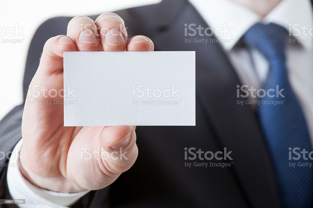 Unrecognizable businessman holding a visiting card stock photo