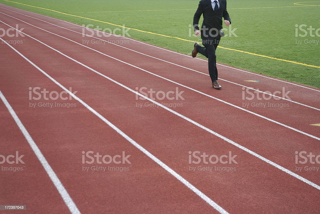 Unrecognizable Businessman Running Outdoors on Sports Track stock photo