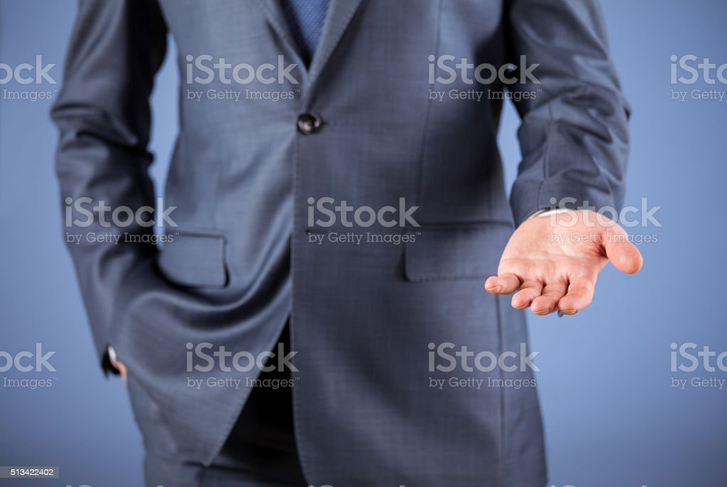 Unrecognizable businessman showing an empty palm stock photo