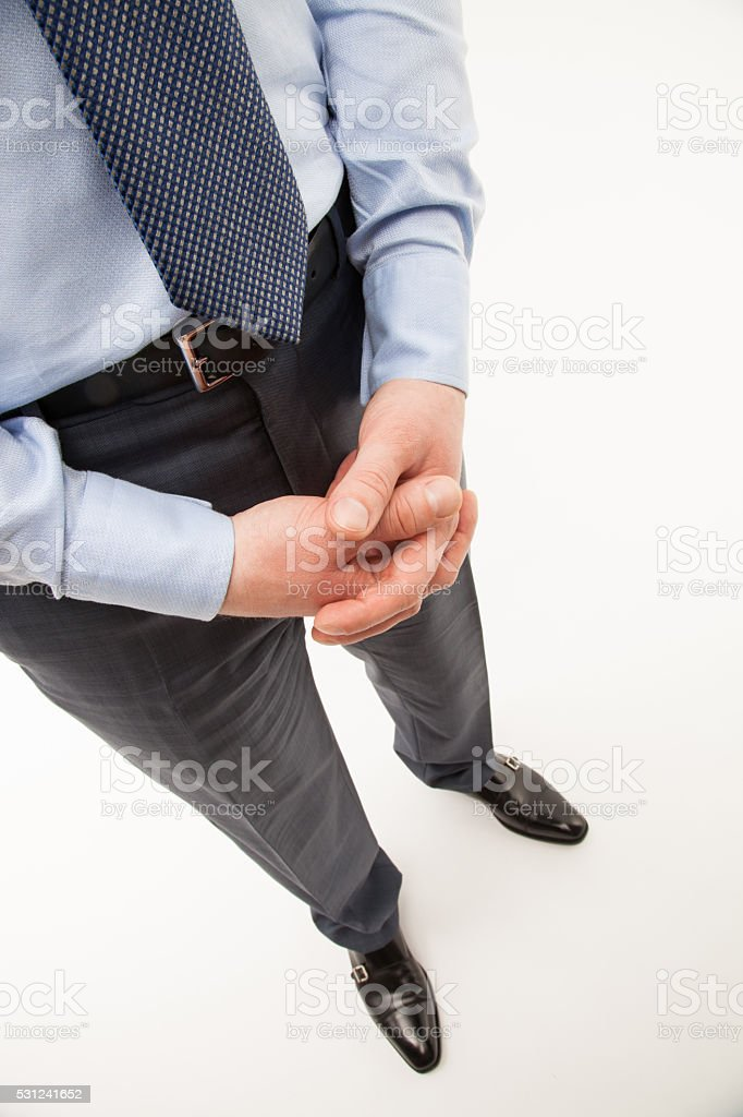 Unrecognizable businessman  standing in a pending pose stock photo