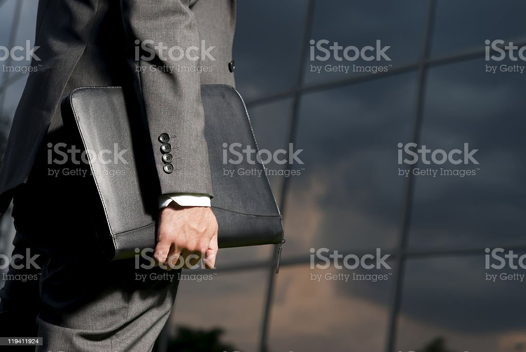 Unrecognizable businessman with suitcase working late concept stock photo