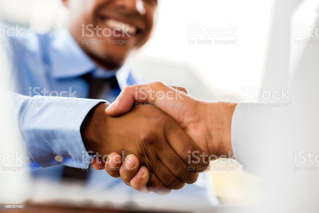 Unrecognizable businessmen shaking hands. stock photo