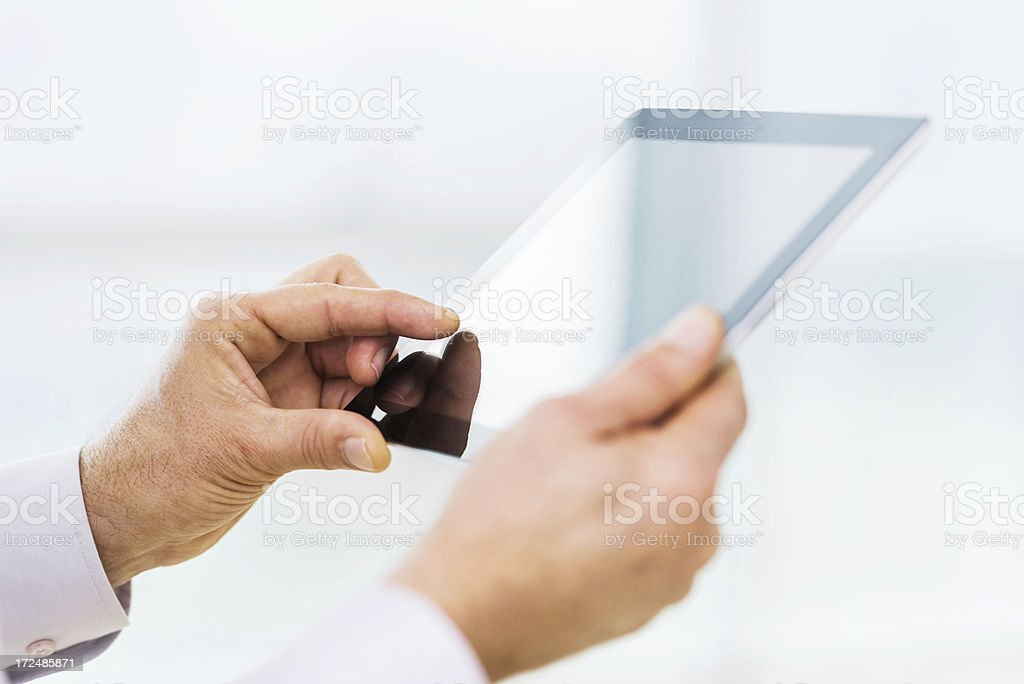 Unrecognizable businessperson using a touchpad. royalty-free stock photo