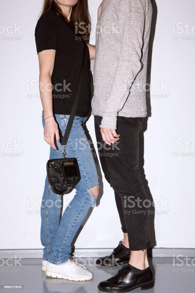 Unrecognizable casual couple with camera stock photo