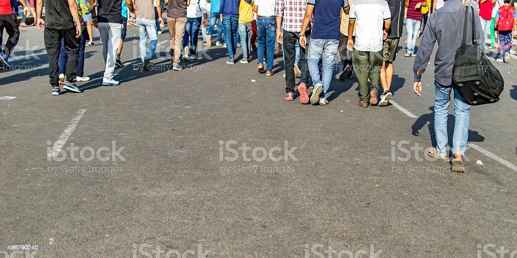 Unrecognizable crowd walking stock photo