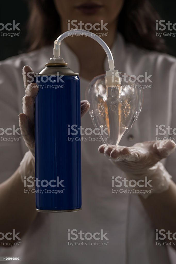 Unrecognizable female doctor holding can with oxygen stock photo