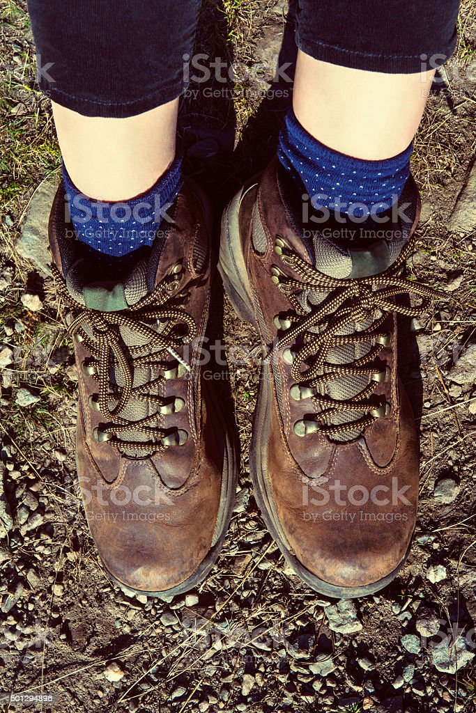 Unrecognizable female hiker wearing hiking boots, Loch Katrine, Highlands, Scotland stock photo