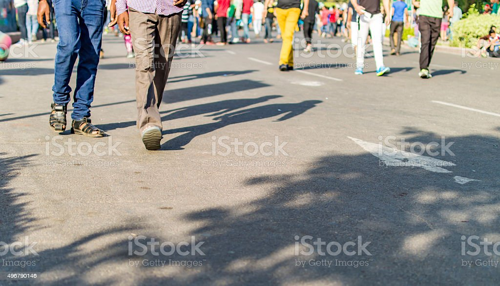 Unrecognizable group of people walking stock photo
