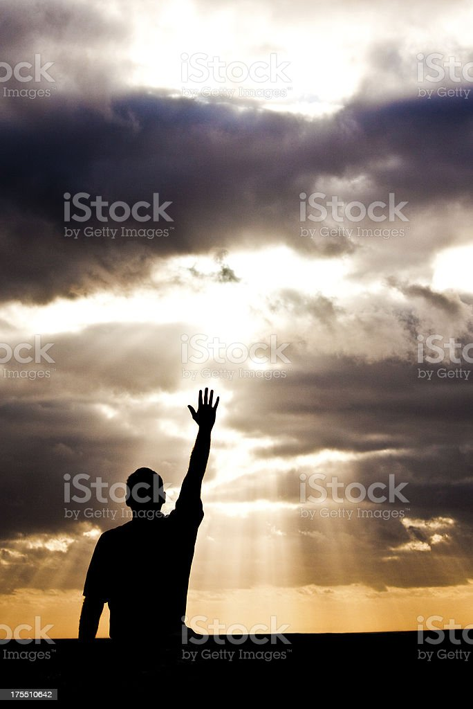Unrecognizable Male Lifting Hand in Praise and Worship stock photo