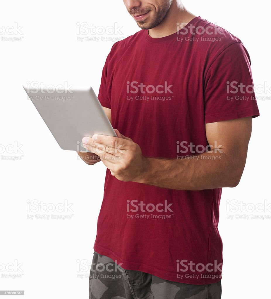 Unrecognizable man, browsing internet on tablet PC royalty-free stock photo