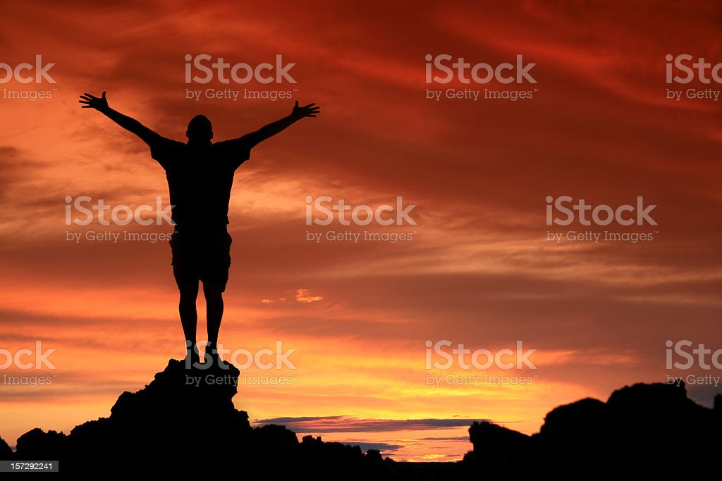 Unrecognizable Man In Praise and Worship Silhouette stock photo
