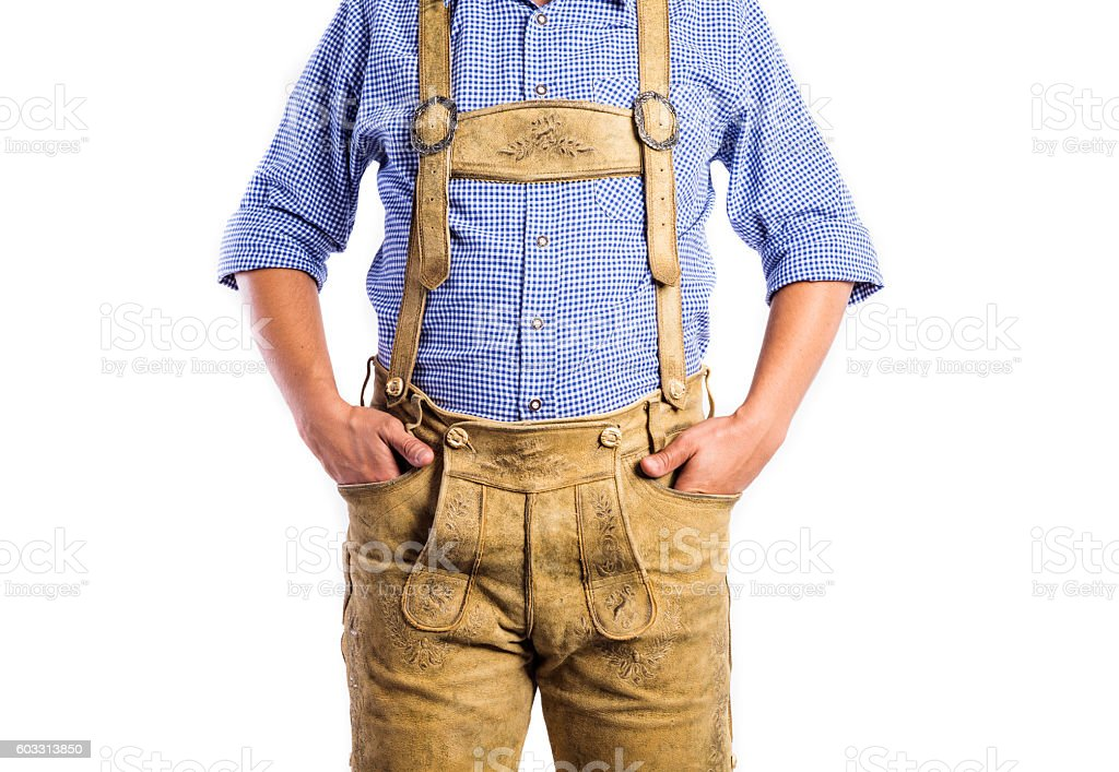 Unrecognizable man in traditional bavarian clothes, hands in poc stock photo