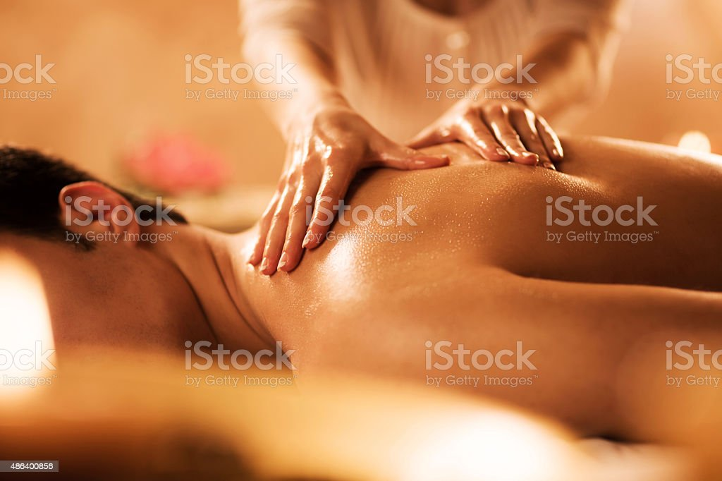 Unrecognizable man receiving massage at the spa. stock photo