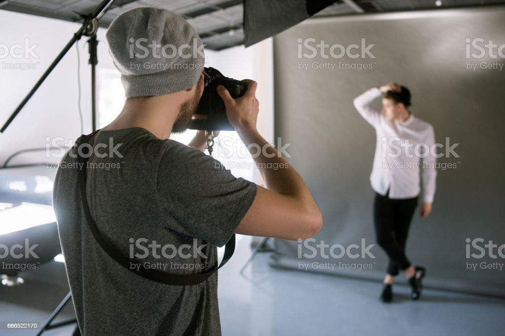 Unrecognizable man shooting male model stock photo