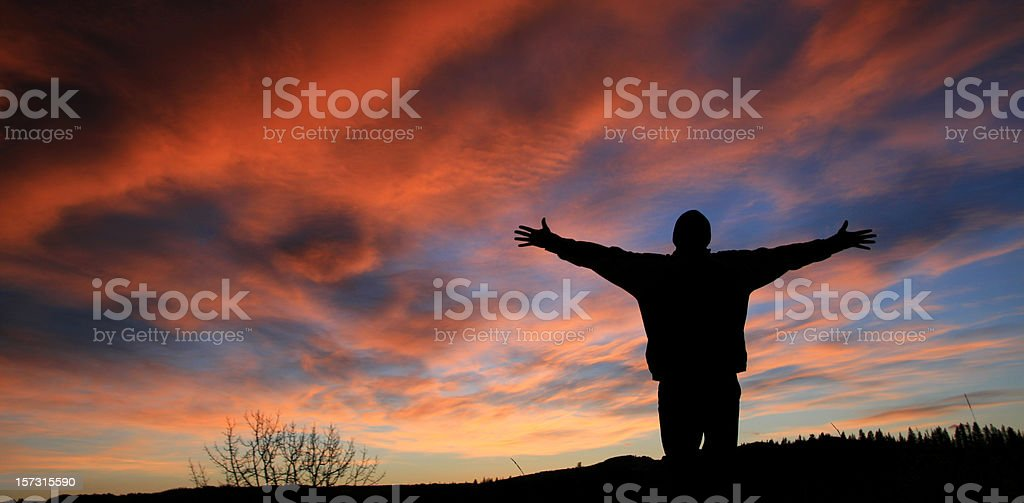 Unrecognizable Man With Arms Outstretched in Worship stock photo