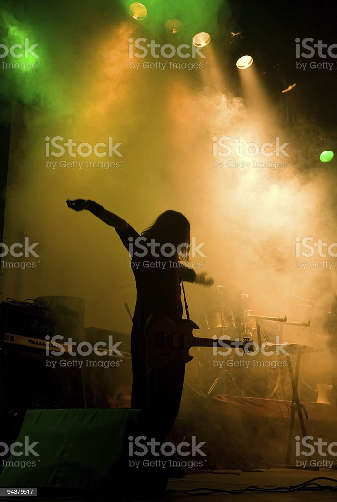 Unrecognizable musician on the stage royalty-free stock photo