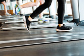 Unrecognizable people running on treadmills