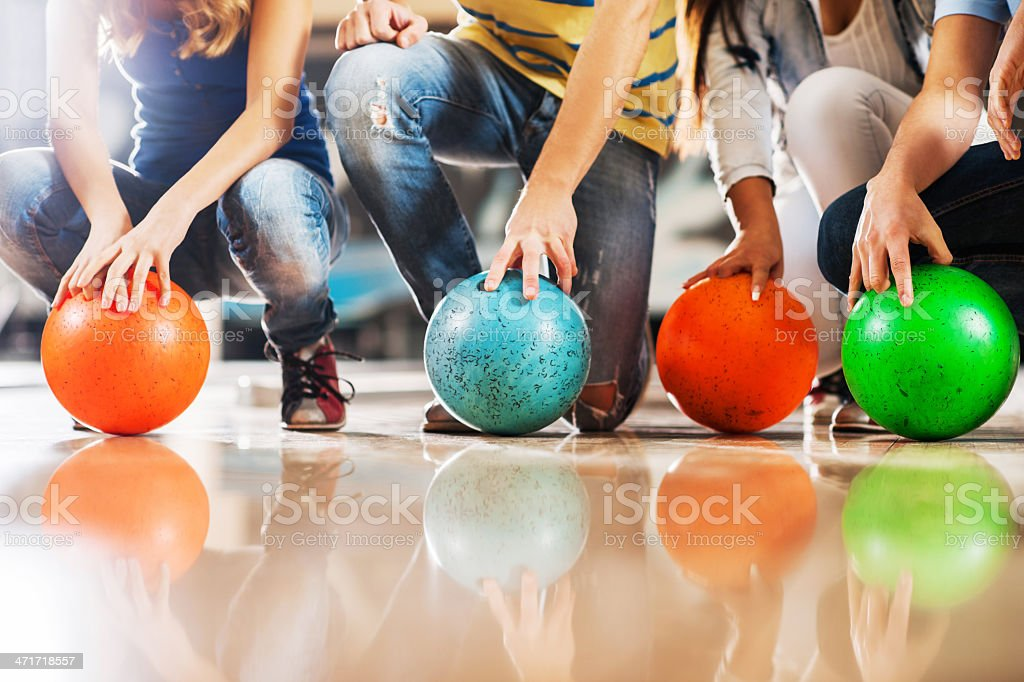 Unrecognizable people with bowling balls. stock photo
