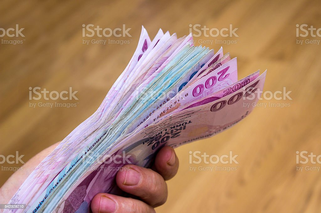 Unrecognizable person counting Turkish banknotes stock photo