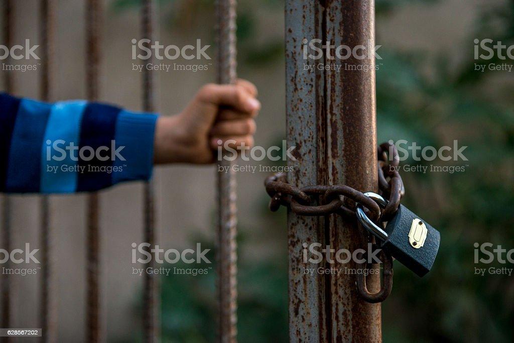 Unrecognizable person holding locked door stock photo