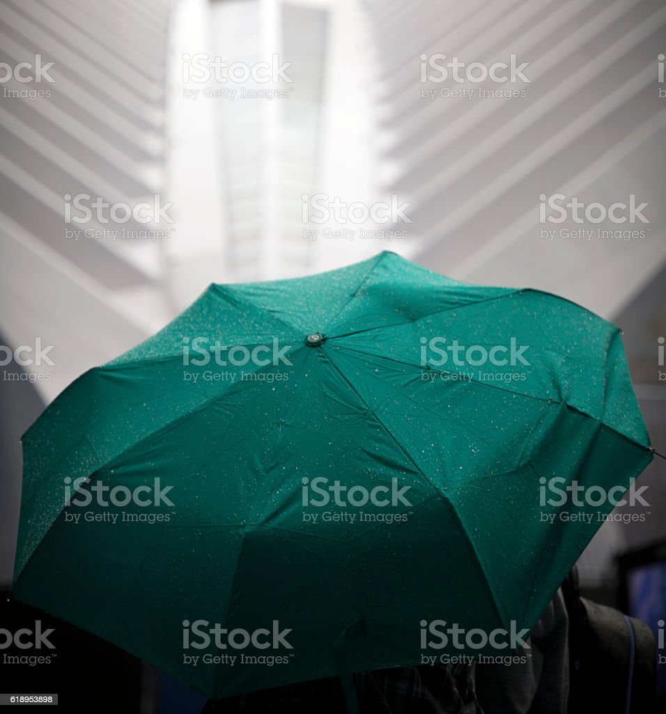 Unrecognizable Person Holding Umbrella While Walking On Street stock photo