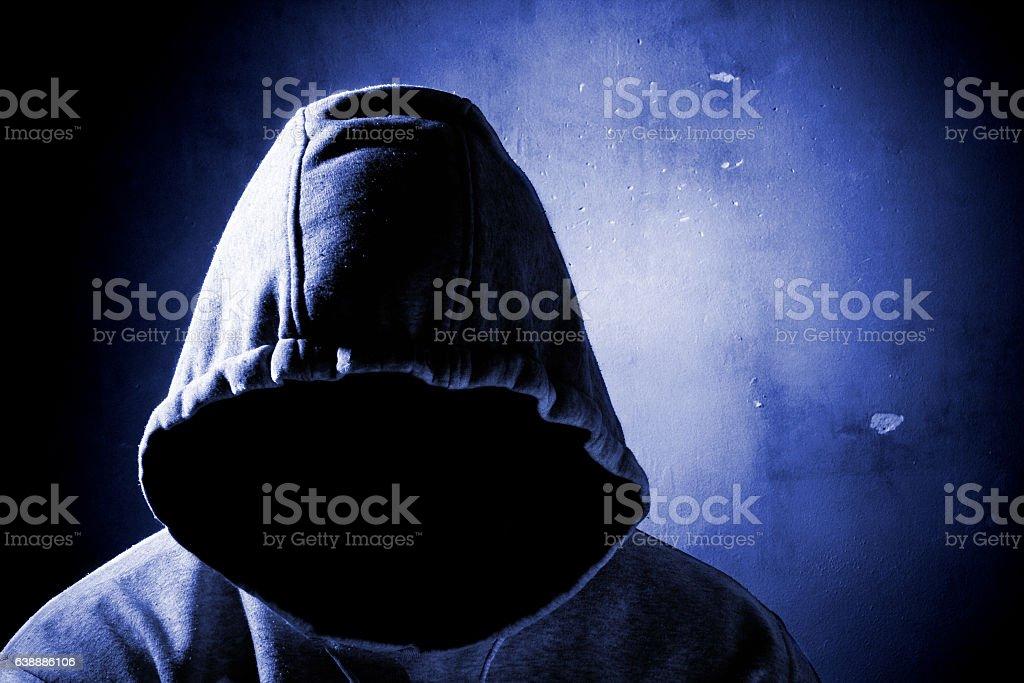 dangerous man with hidden face
