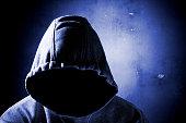 unrecognizable person in the shadow