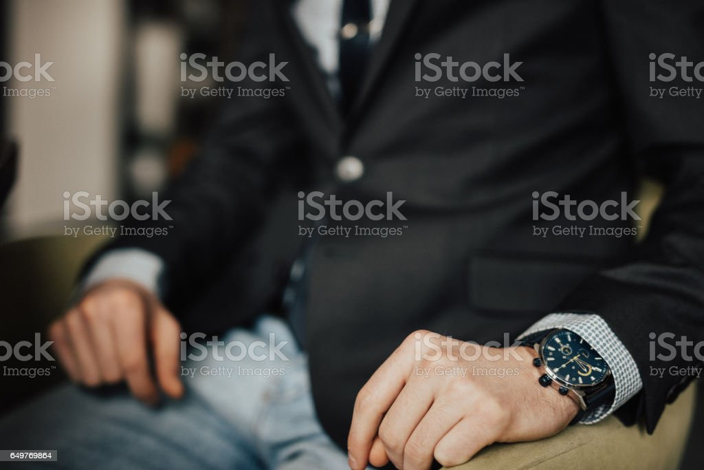 Unrecognizable person wearing luxury clothes stock photo