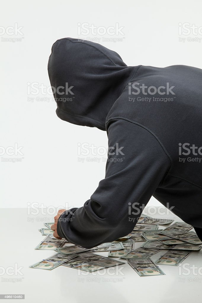 Unrecognizable robber stealing money stock photo