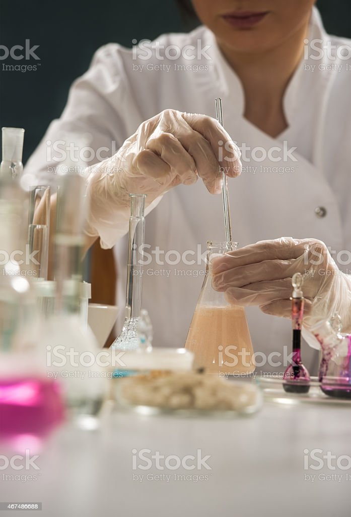 Unrecognizable science professional working with the glass cuvette stock photo