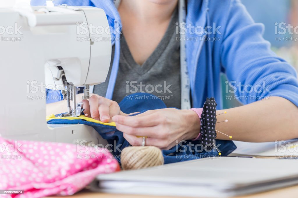 Unrecognizable tailor in workshop stock photo