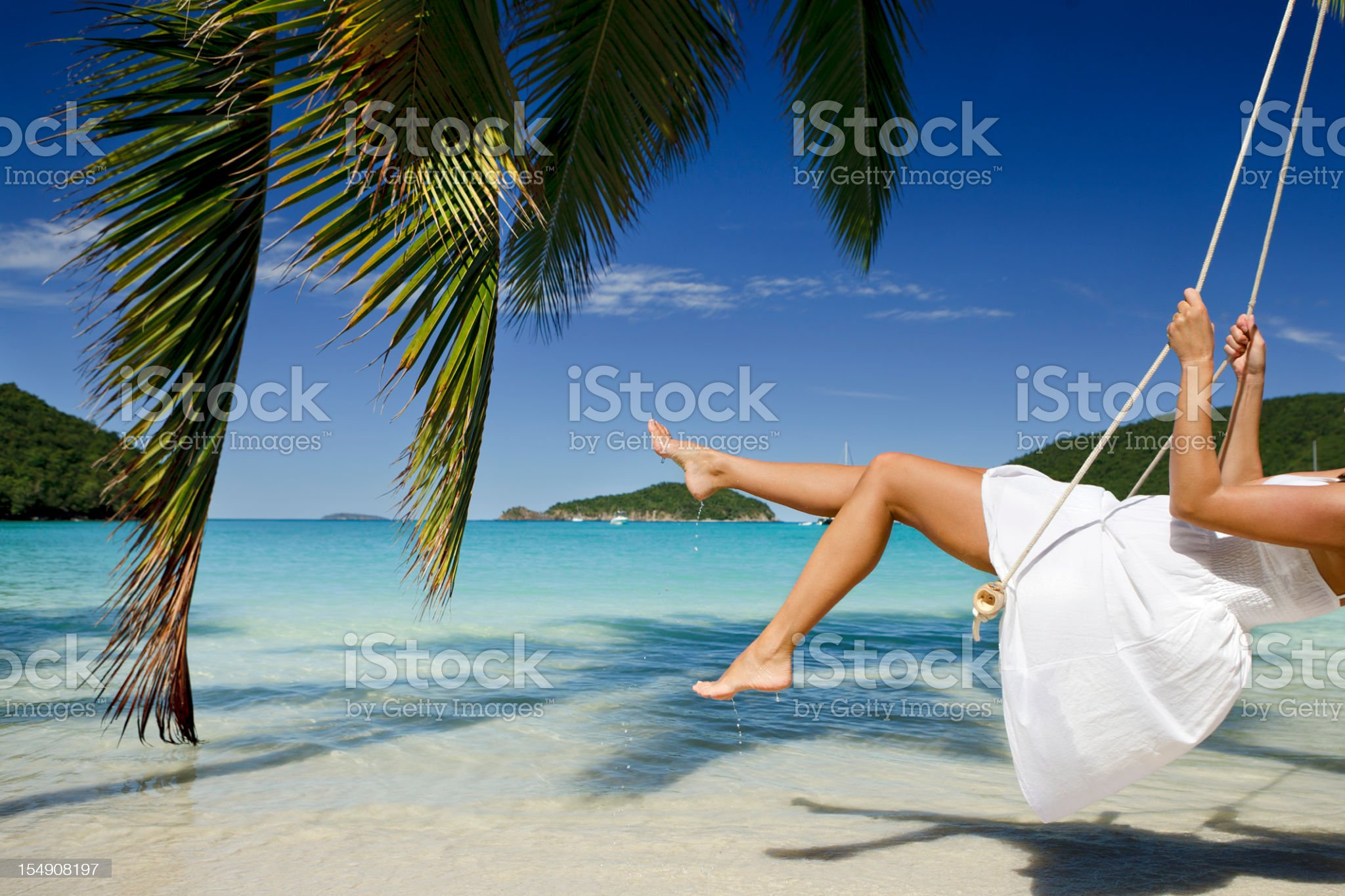 unrecognizable woman swinging at a beach in the Caribbean royalty-free stock photo