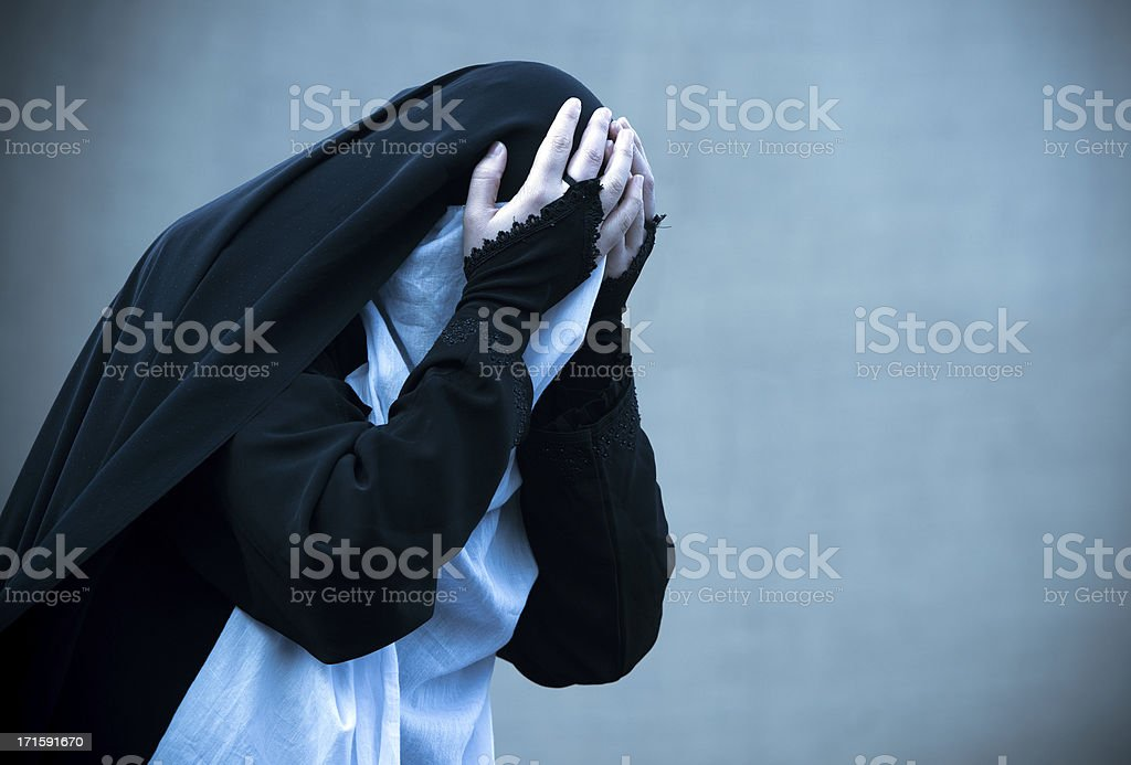 Unrecognized muslim woman crying stock photo