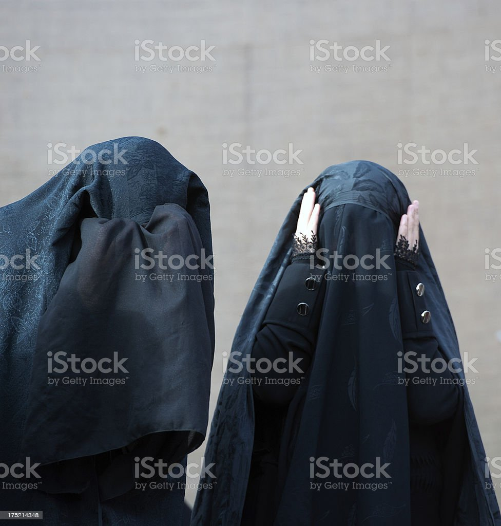 Unrecognized muslim women are crying stock photo