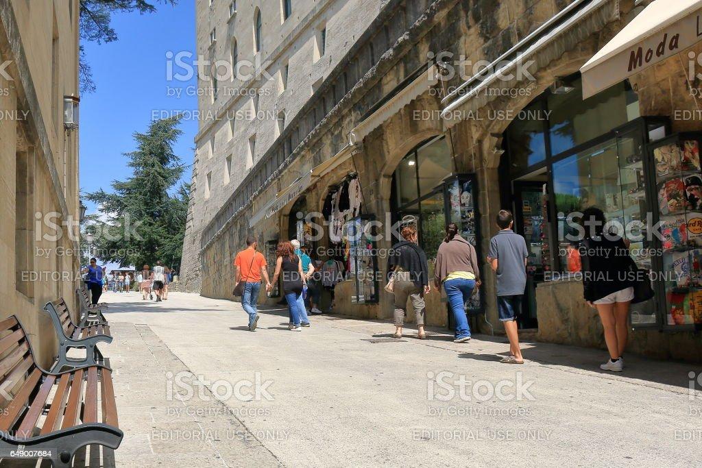 Unrecognized people near shop on Via Eugippo in San Marino stock photo