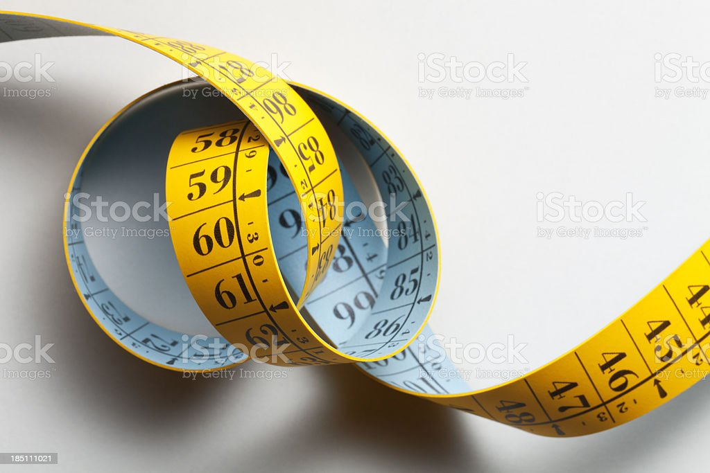 Unrolled and twisted tape measure stock photo