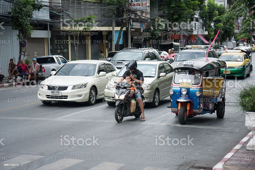 Unsafe father and son on motorbike stock photo