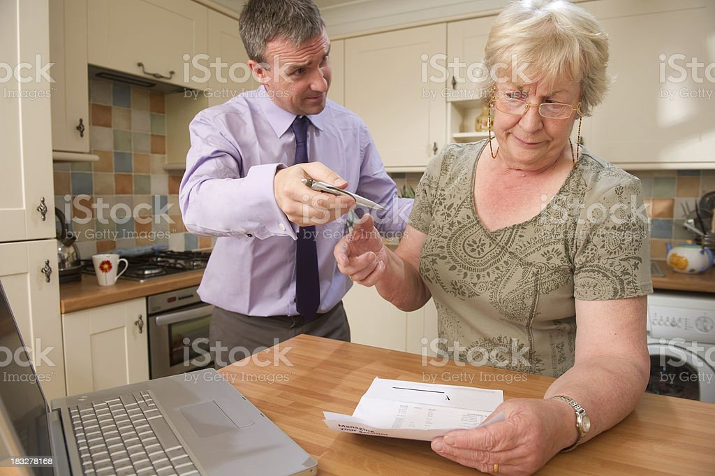 Unscrupulous Businessman and Senior Woman royalty-free stock photo