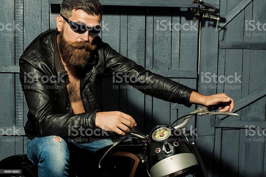 Unshaven male biker stock photo