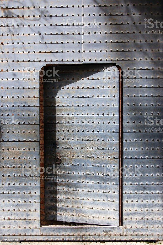 Unshut steel door and shadow stock photo