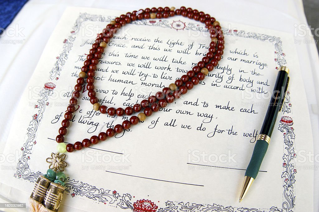 Unsigned Wedding Certificate and Rosary Beads in Church stock photo