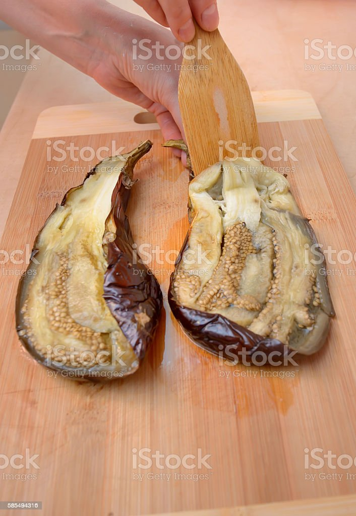 Unskin roasted eggplants stock photo