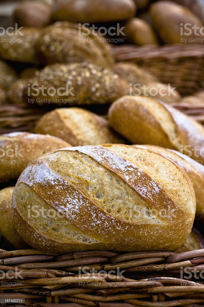 Unsliced loaves of bread in a basket royalty-free stock photo