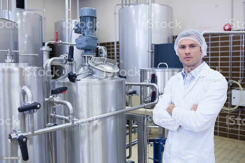 Unsmiling biologist with arms crossed stock photo