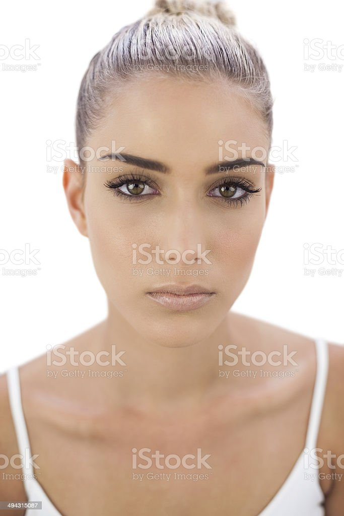 Unsmiling woman looking stock photo