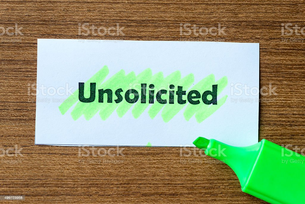 unsolicited word hightlighted stock photo