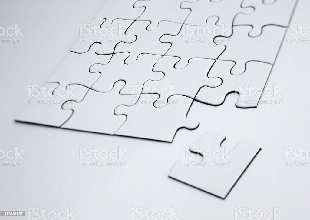 Unsolved jigsaw puzzle royalty-free stock photo