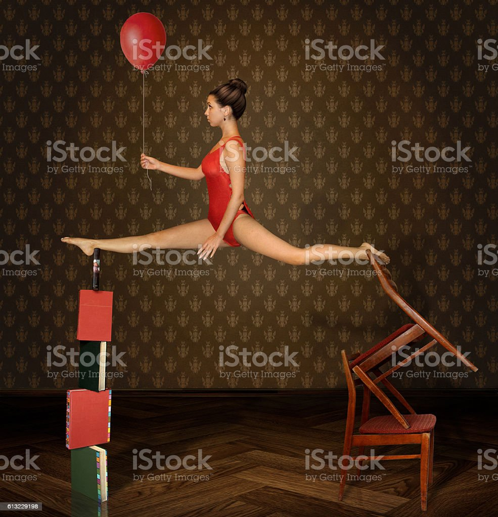 Unstable equilibrium, girl and red balloon stock photo