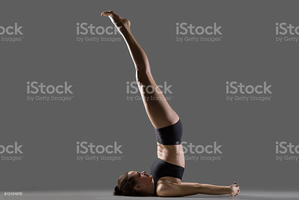 Unsupported Shoulder stand yoga pose stock photo